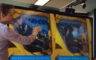 Senior Engineer Erik Salters stellte auf dem heutigen Hamburger Symposium Die Zukunft der Kindersicherheit den Maxi-Cosi mit eingebauten Airbags vor.
